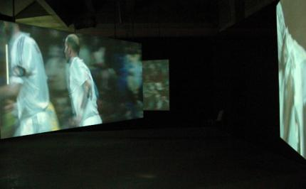 Installation view of: Zidane, a Twenty-First-Century Portrait by Philippe Parreno and Douglas Gordon
